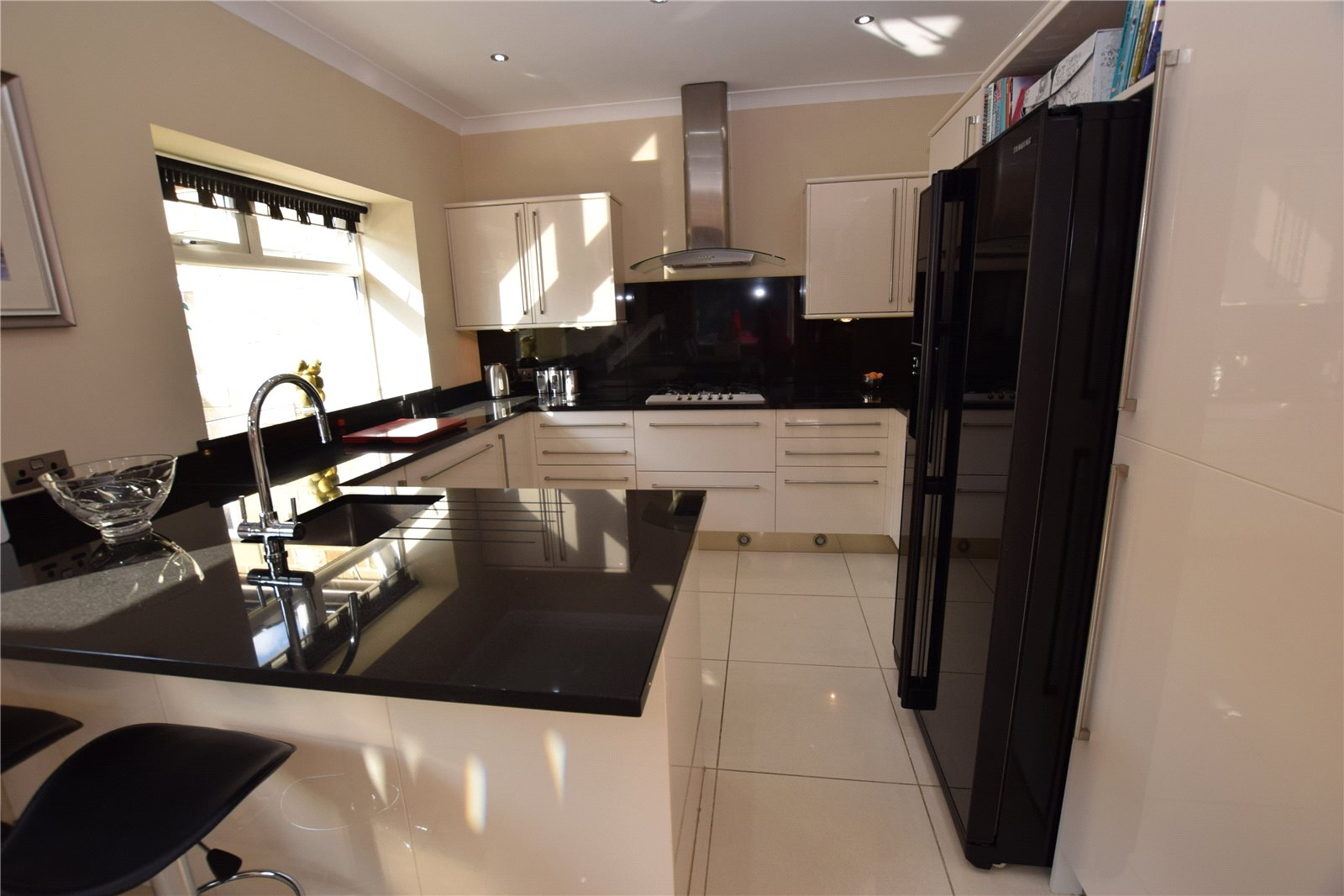 Property for sale in Wortley, kitchen area, sleek and modern black and white finish