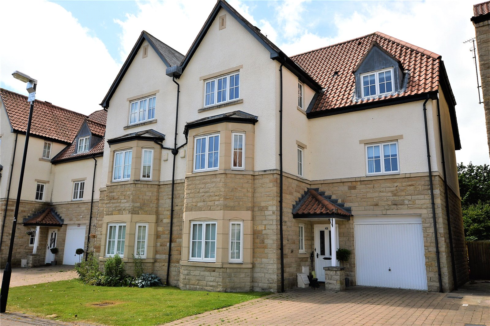 property for sale in Wetherby, exterior of home half stone half plaster