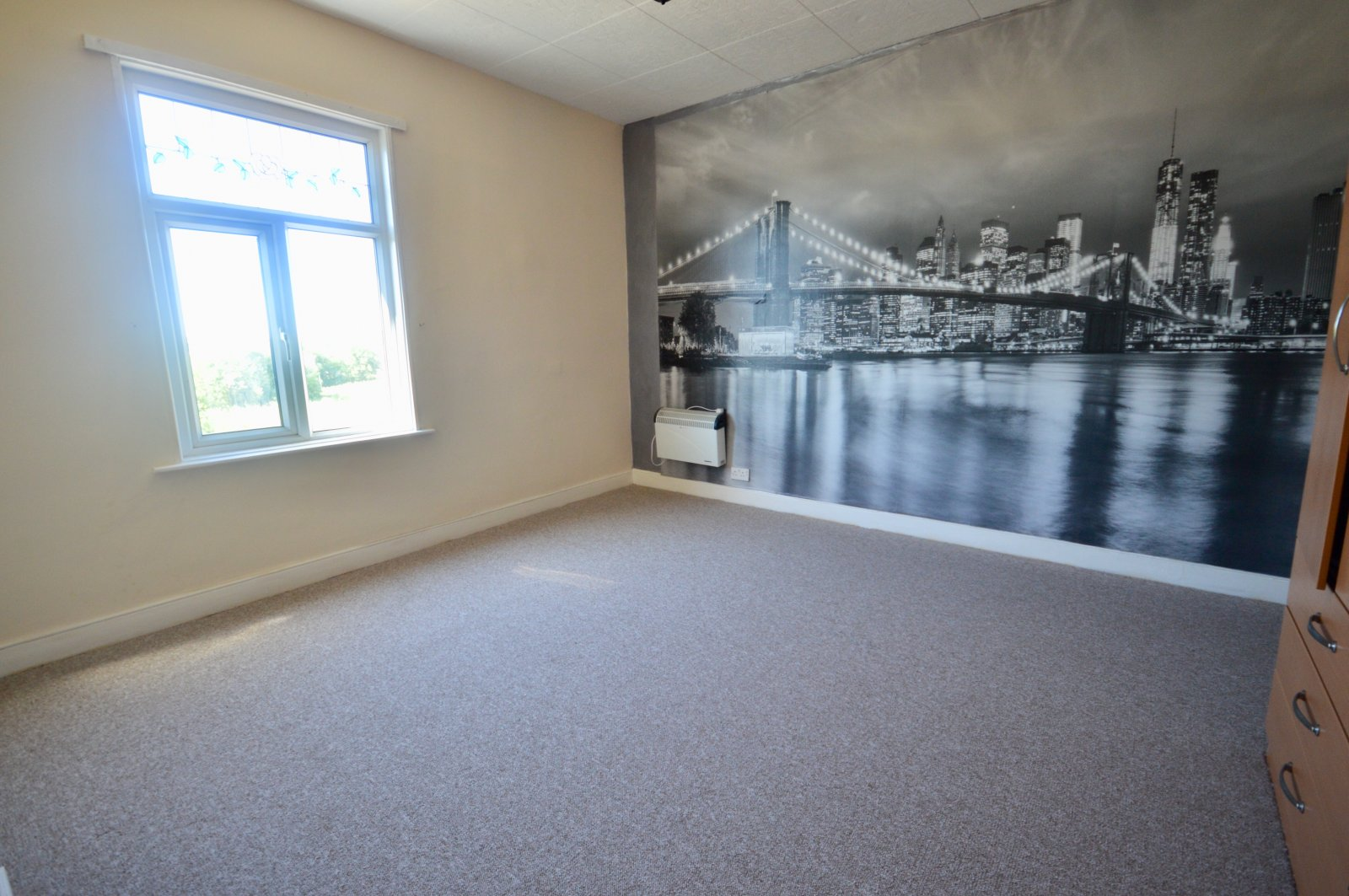 Property for sale in Wakefield, bedroom area, feature wall, skyline wall paper