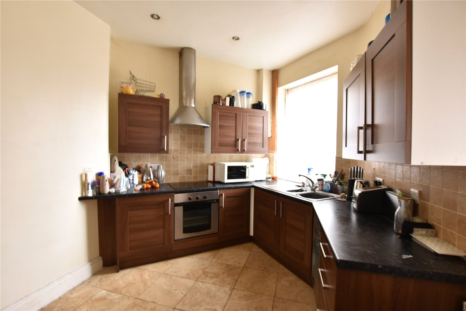 Property for sale in Morley, kitchen area, dark wood cabinets and oven