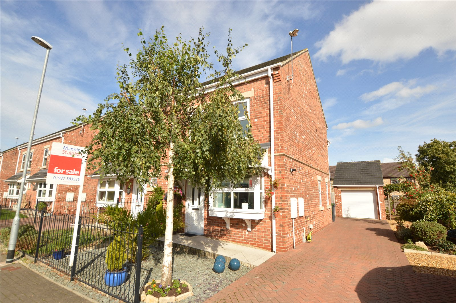 property for sale in Wetherby, exterior semi detached red brick home