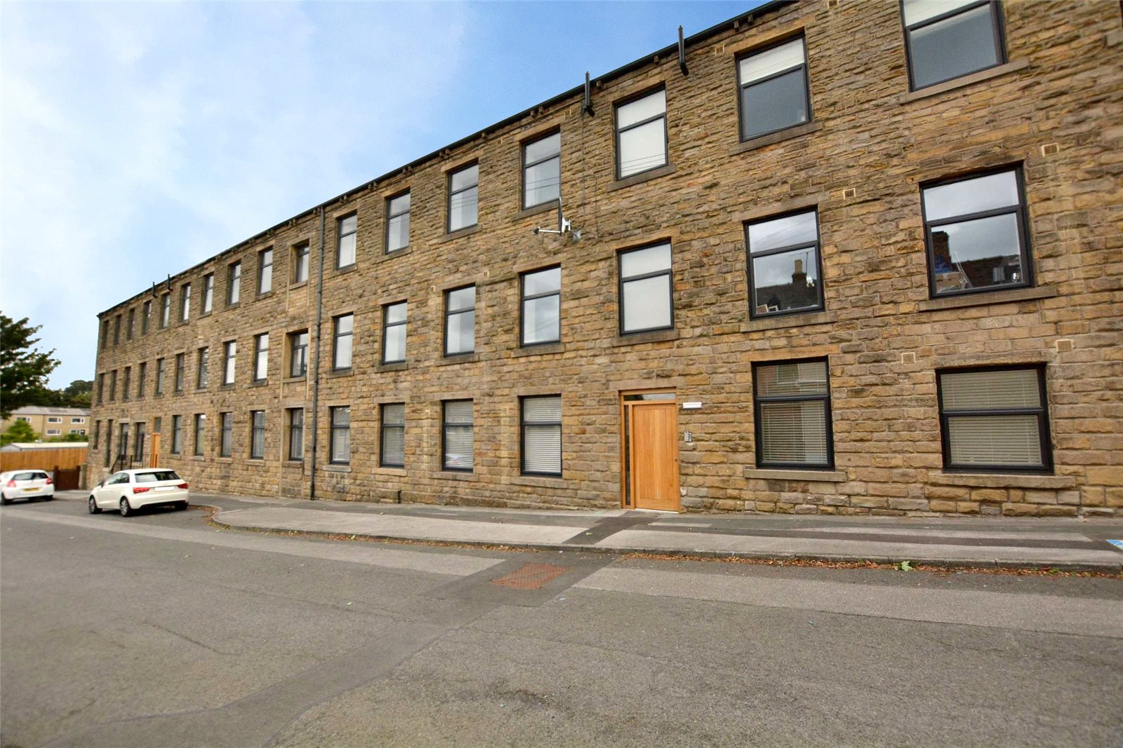 apartment for sale in Pudsey, exterior three floor apartment complex